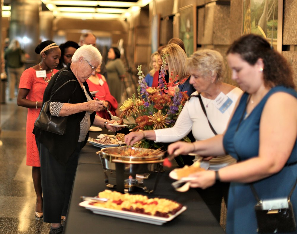 Guests enjoying  hors d'oeuvres  provided by UMB