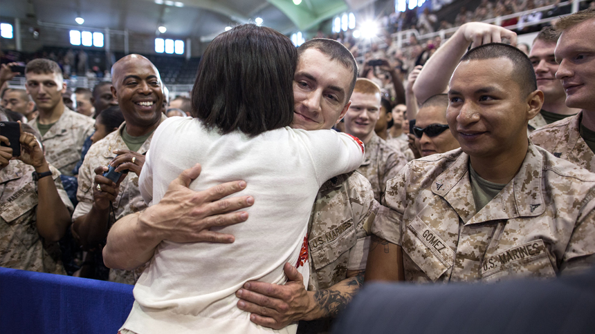 First Lady Michelle Obama hugs troops