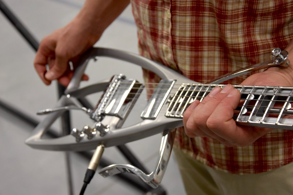 Péter Üveges aluminium electric guitar design. See more at www.up-design.hu