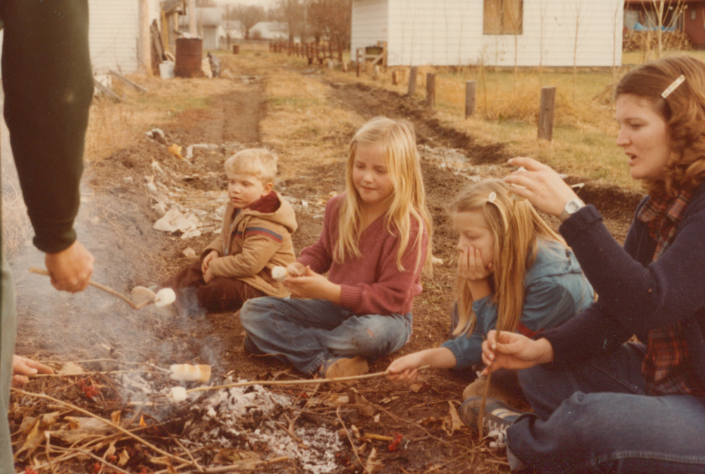 One time we were burning leaves in the alley - you could do it back then - Grandma ran in the house and grabbed marshmallows for roasting. She loved that story and told me about it on Mother's Day.  That's my mom, sisters, and my cousin Travis.