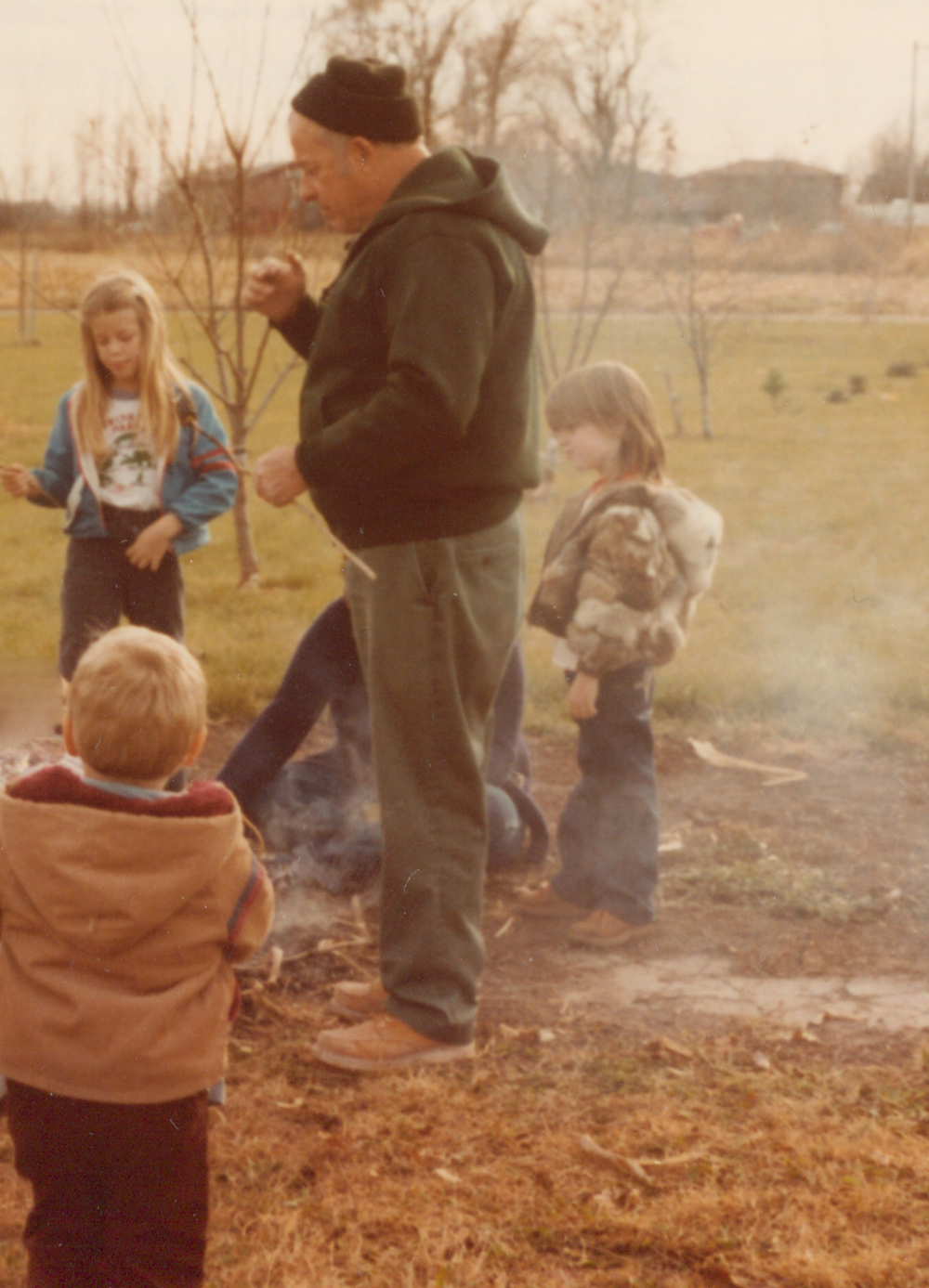 That's Grandpa! He's the coolest.  Oh and that's me in the fake rabbit fur coat and Joe Dirt haircut.  (thanks for that, mom)