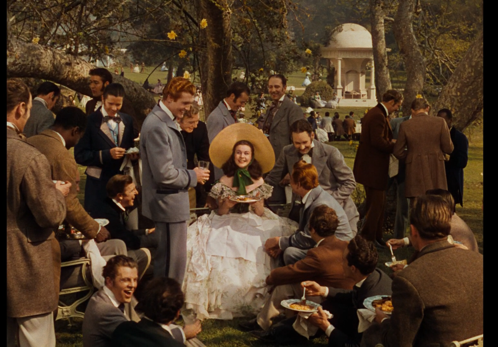 "Scarlett O'Hara at the Wilkes' Barbeque, moments before Civil War breaks, in the top winner of 1939 Oscars, ""Gone With The Wind"""