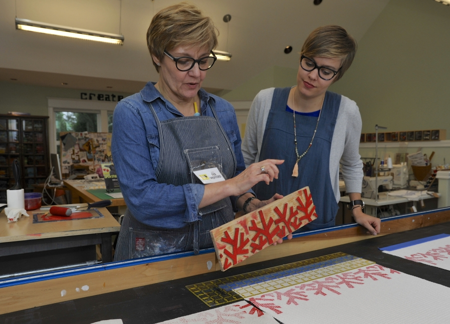 Deb Spofford, left, and her daughter Abi Spofford are on hand to welcome guests Sunday to the Felida-area studio during the 2016 Clark County Open Studios tour. Deb Spofford demonstrated how she block prints ink onto fabric. (Greg Wahl-Stephens for the Columbian)