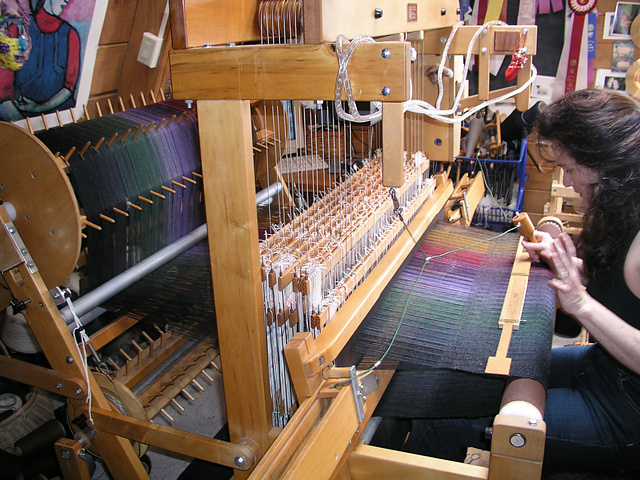 Anne working at her loom