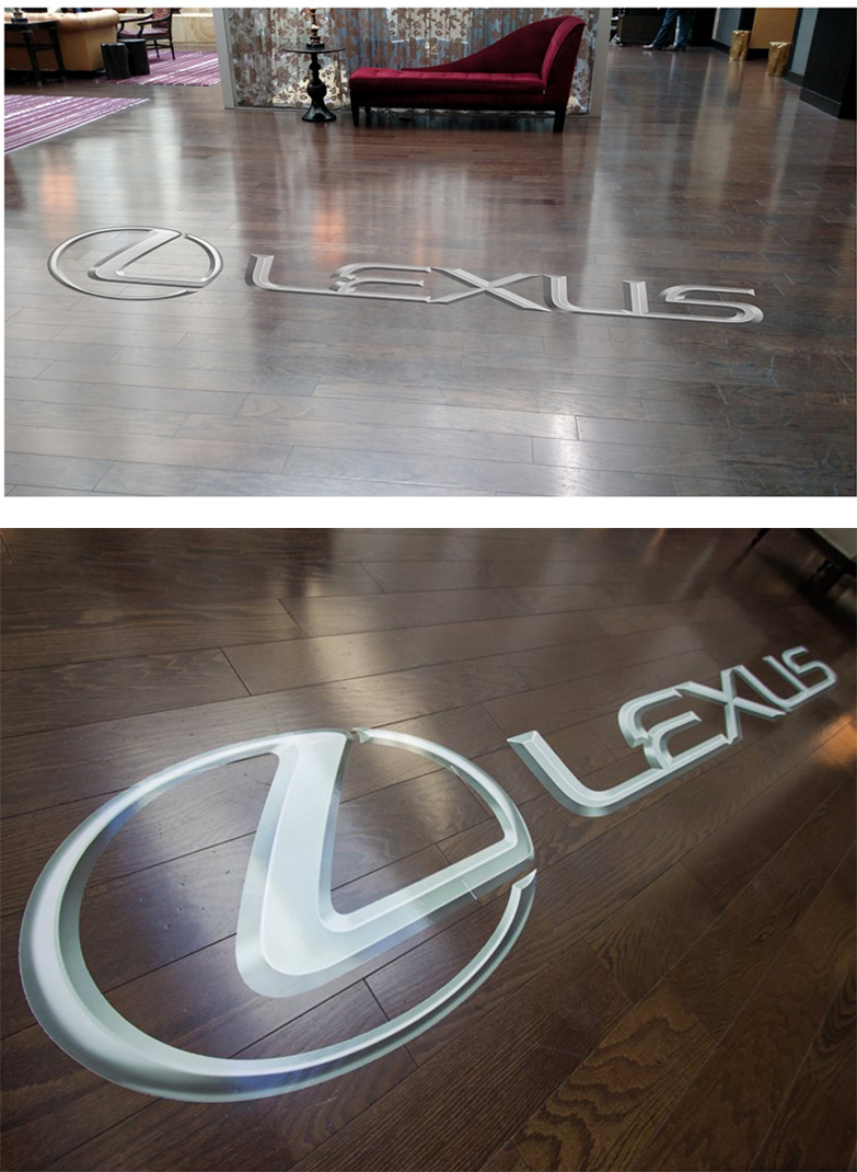 Logo floor graphic   -  Measurements were key in the creation of all elements. Space was limited, and accurately sized mock-ups were key to client sign offs. Above is the mock-up, below is the real application.