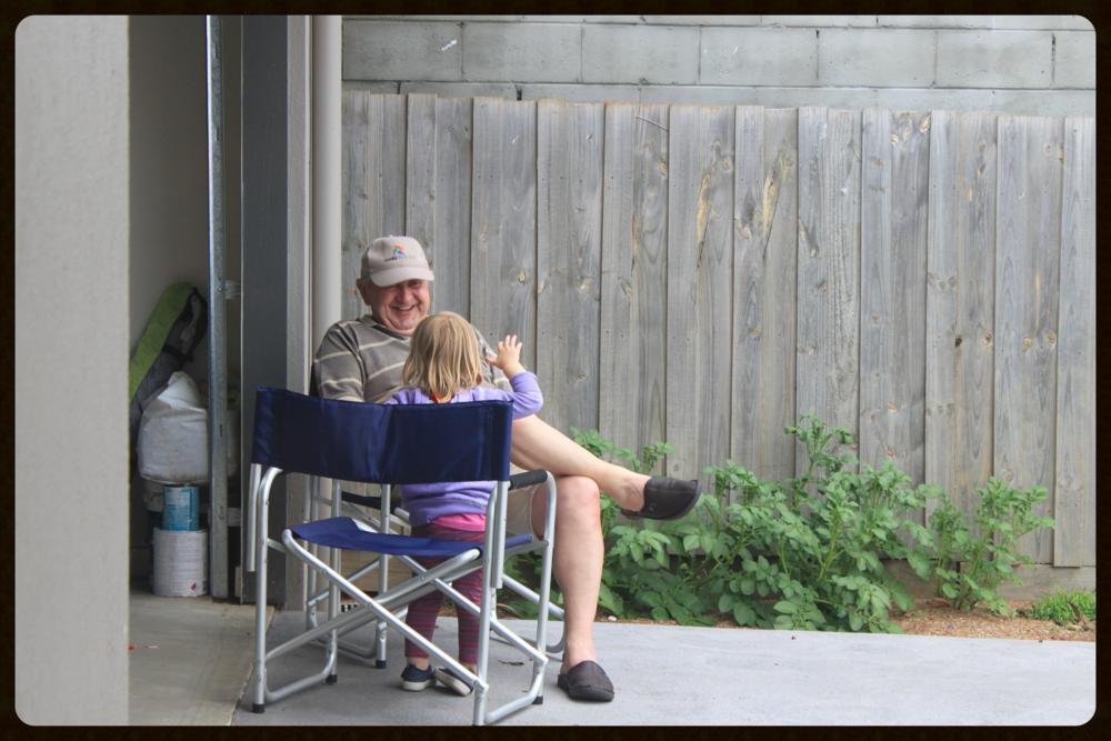 Grandkiddo Jade telling my Dad the ways of her world.