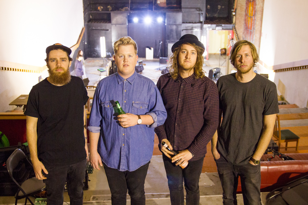 Flamingo behind the scenes of their 'At Sea' film clip at an abandoned Adelaide cinema. Left to right: Benny Tamblyn, Oli Kirk, Kacee Heidt and Miles Sly.