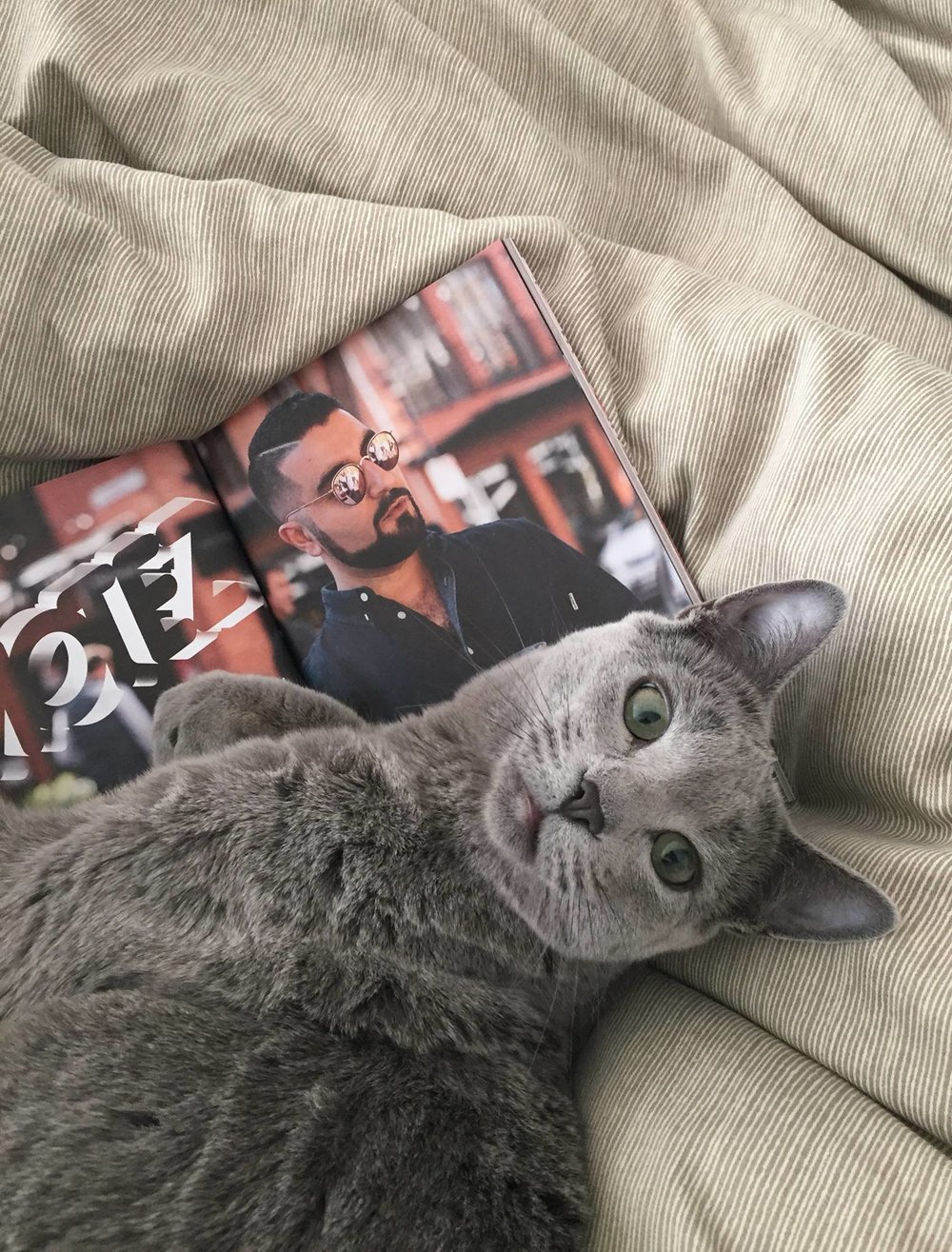 Motez in print with one cool cat. Photo by Lisa Bishop.