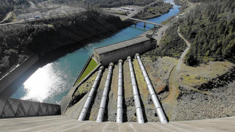Water captured in Lake Shasta flows to the hydroelectric power plant at the base of Shasta Dam in 2012. The reservoir is now filled to 50% of capacity, cutting the dam's power production by about a third. (Paul Chinn, San Francisco Chronicle)