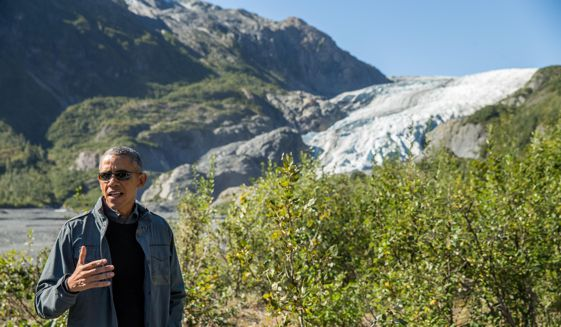 President Barack Obama speaks to members of the media while on a hike to the Exit Glacier in Seward, Alaska, Tuesday, Sept. 1, 2015, which according to National Park Service research, has retreated approximately 1.25 miles over the past 200 years. (AP Photo/Andrew Harnik)