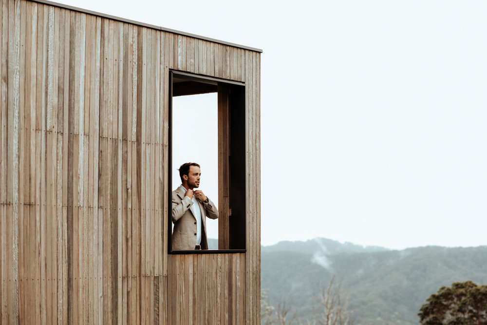 Groom Tom in the cabin overlooking the Byron Bay Hinterland at Altitude 261. One of my favourite photos from this mountain wedding.