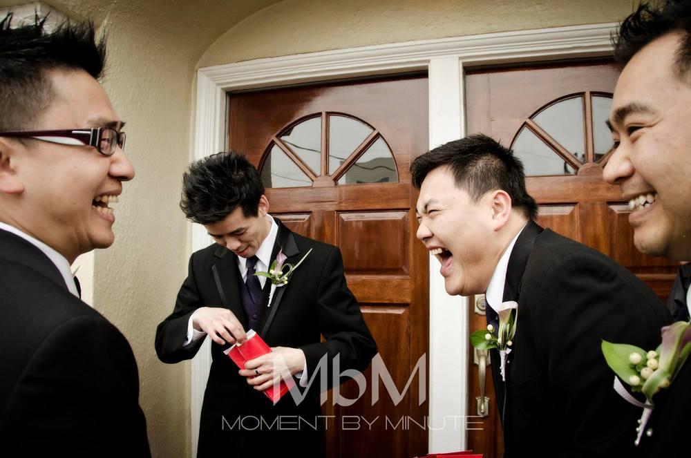 Groomsmen preparing to pick up bride during bridal pick up games.