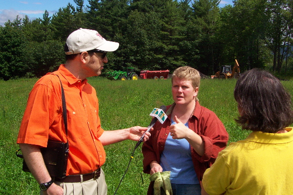 A New Hampshire Public Radio reporter interviews the owner of a hay field as biosolids are being applied (central NH).