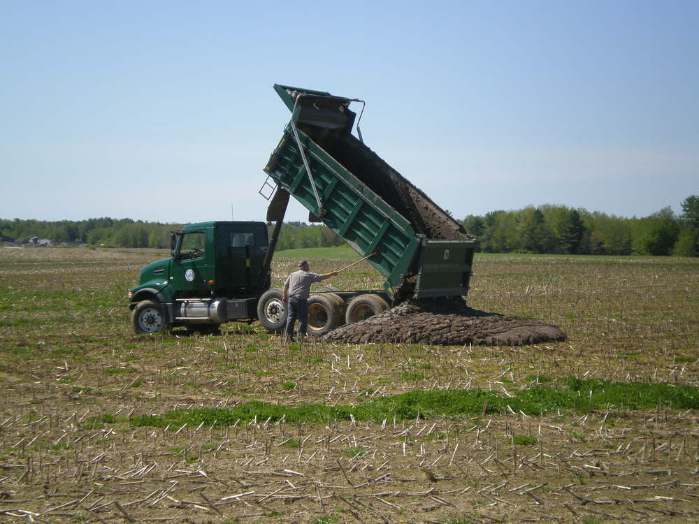 Delivering Class B biosolids to corn field, Quebec.