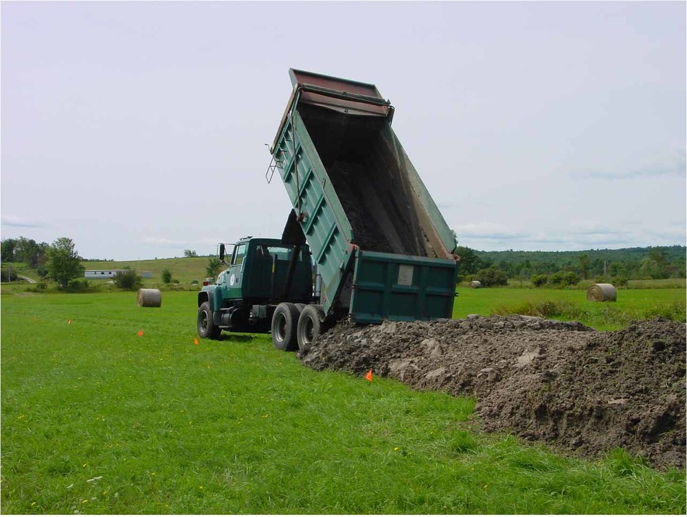 Stockpiling Class B biosolids for application between cuts of hay, central Maine.