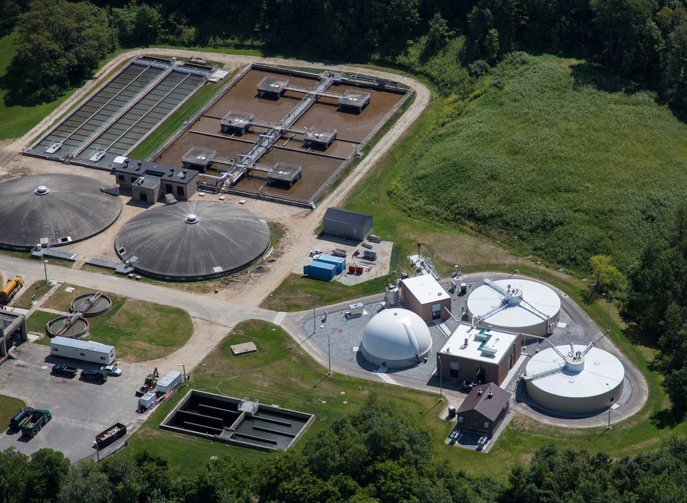 The LAWPCA water resource recovery facility, with the new anaerobic digestion complex at the right (white gas dome & 2 round digesters).