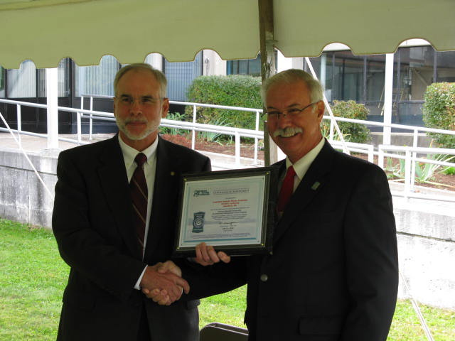 Phil Nadeau, then Chair of the LAWPCA Board, received National Biosolids Partnership (NBP) certification from Jim Cox of the NBP Biosolids Management Program.