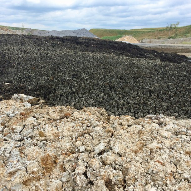 Gypsum residuals (foreground), wastewater biosolids (middle), and paper mill residuals (gray in back) are part of the soil mix used to restore native soil and plant ecosystems at Asbestos, QC.