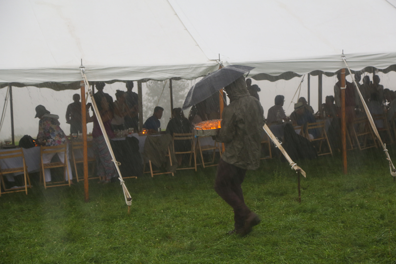 Dinner out in a field means braving the unpredictable elements.