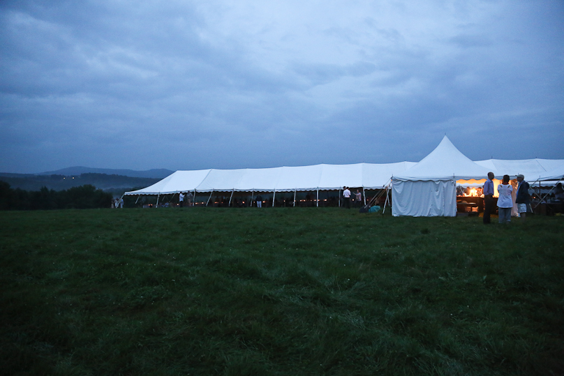 The forecast called for finding a rare tent that could cover one long table that seats two hundred people. The openness allowed people to enjoy the rain and the view... and stay dry.