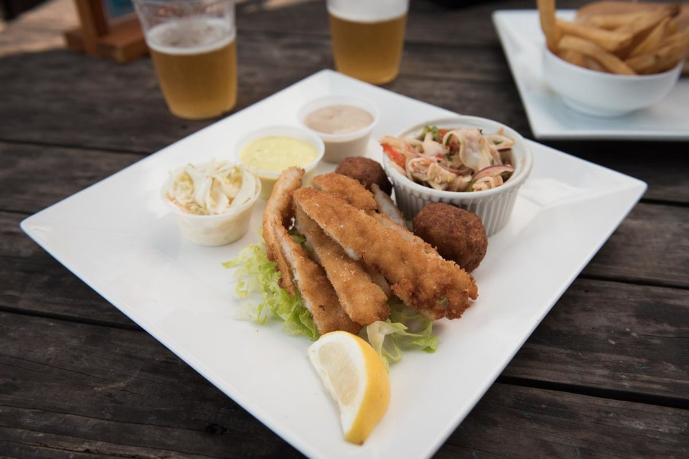 Enjoy a conch platter overlooking the sea at Macabuca Bar | Photo Credit: Find. Eat. Drink.