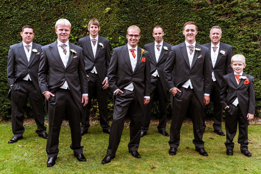 A group photo of all the groomsmen in Marc's parents back garden with the page boy