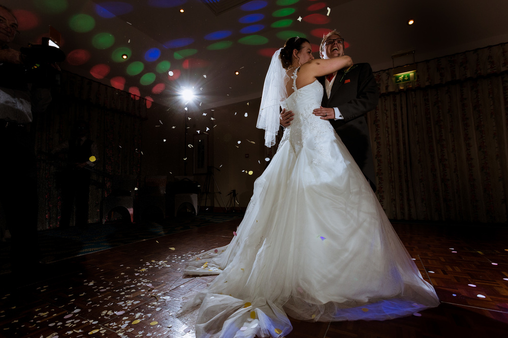 An image from marc and Sarah's first dance, some confetti was thrown over them as they started too dance as they were not able to have a confetti shot due to the rain.