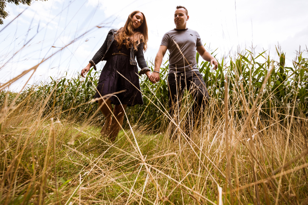 When I can bury myself in tall grass I get couples to hold hands and walk over the top of me, this gives you a great way of pulling in an interesting foreground with a great perspective on the couple