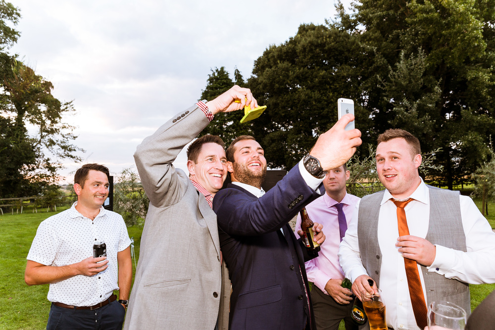 The guys loved the magician, he brought out the inner child in all of the guys and myself, He really helped to capture natural Wedding photographs outside Knowlton Court ,