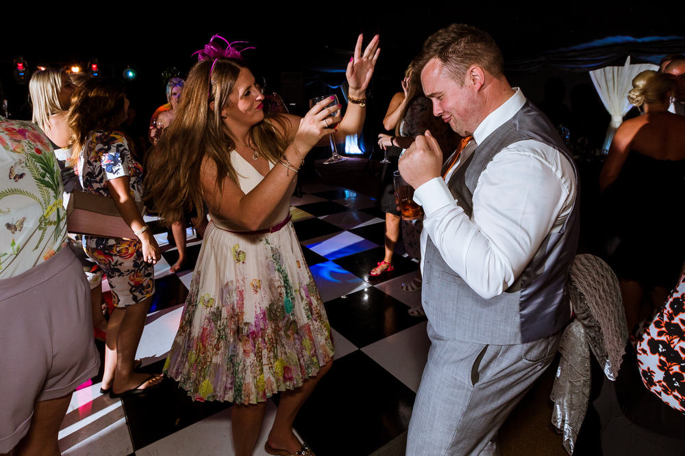 I love to get on the dance floor and dance myself, this way i can get in close and capture the day from a guests perspective, I wont sit far away and try to pick of just faces, I need to see those dance moves!