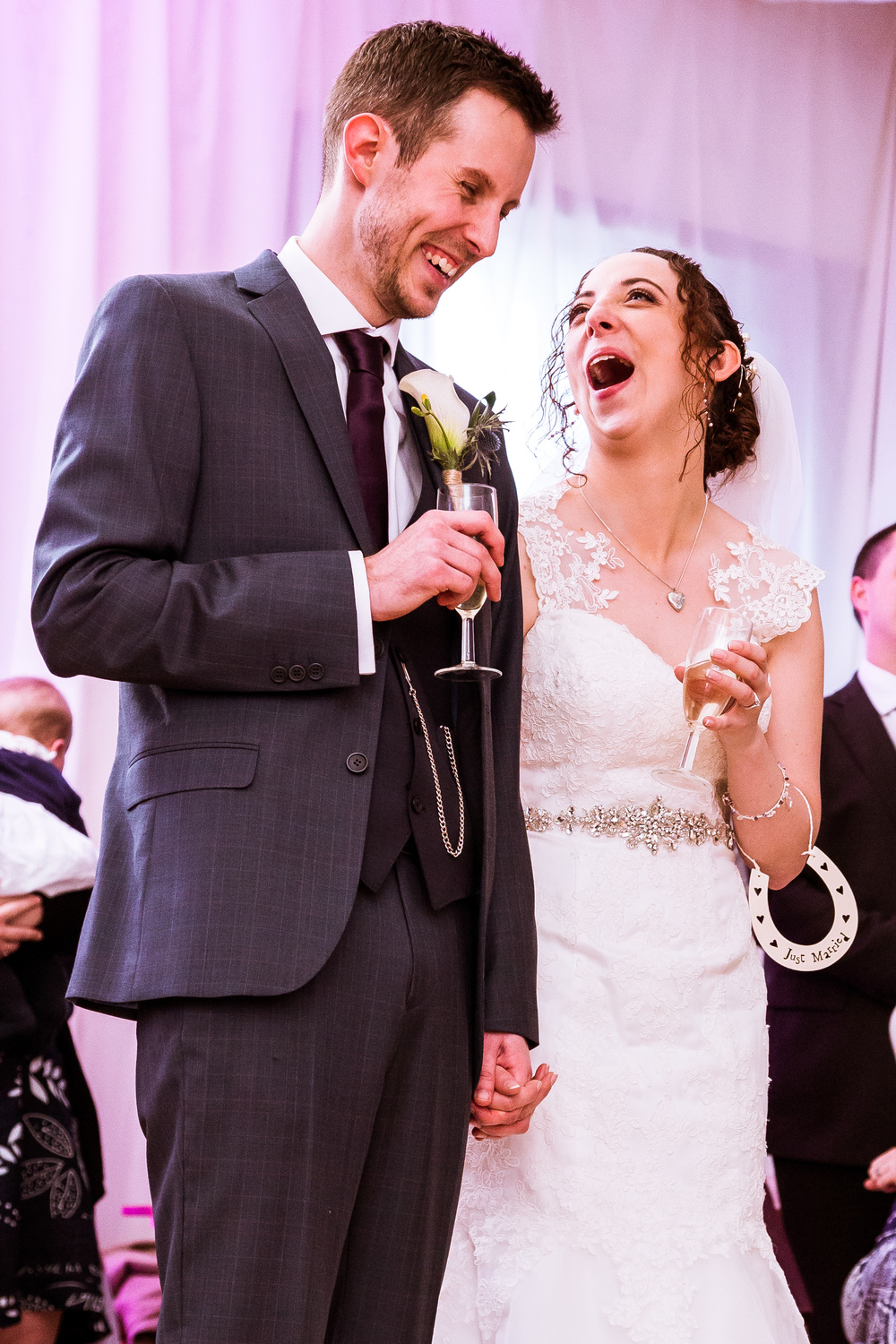 Bride and groom reaction at the speeches at their wedding in kent