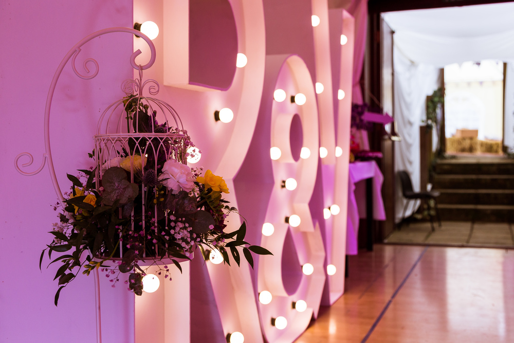 The Groom surprised his bride with some massive five foot letters in lights!