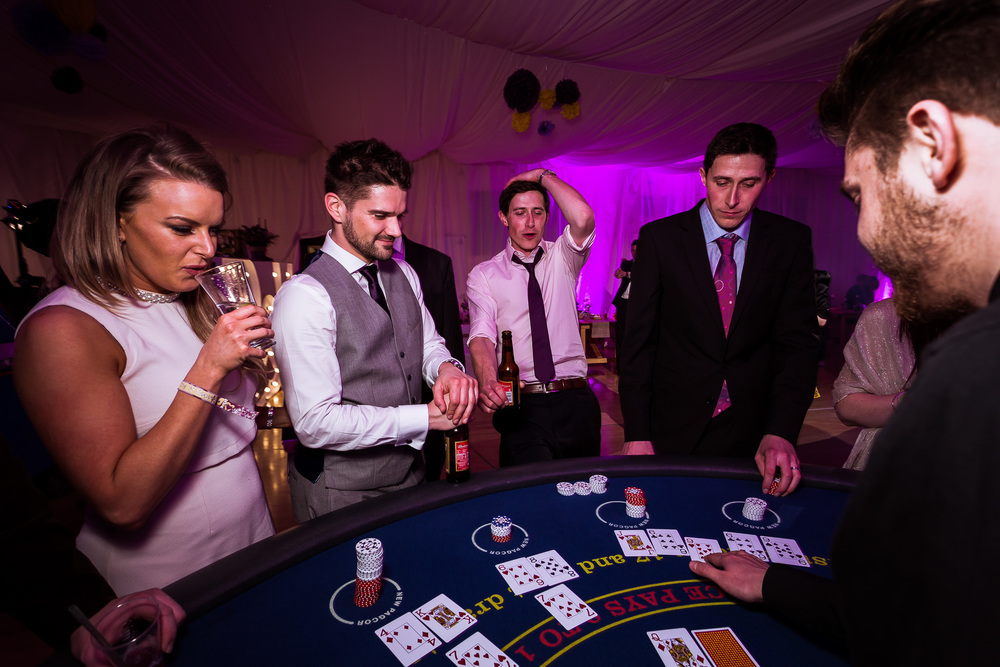 The guests were having great fun with the casino tables at the kent wedding