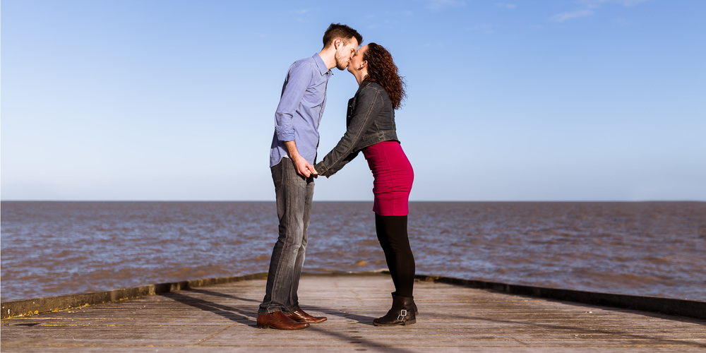 Kissing on the boat launch, I love to find systematical backgrounds to really hold focus on the couple