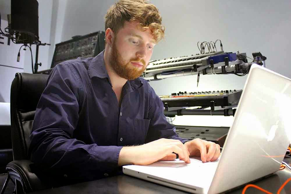 Composer Kit Wilson creating the final mix at his studio in Hackney
