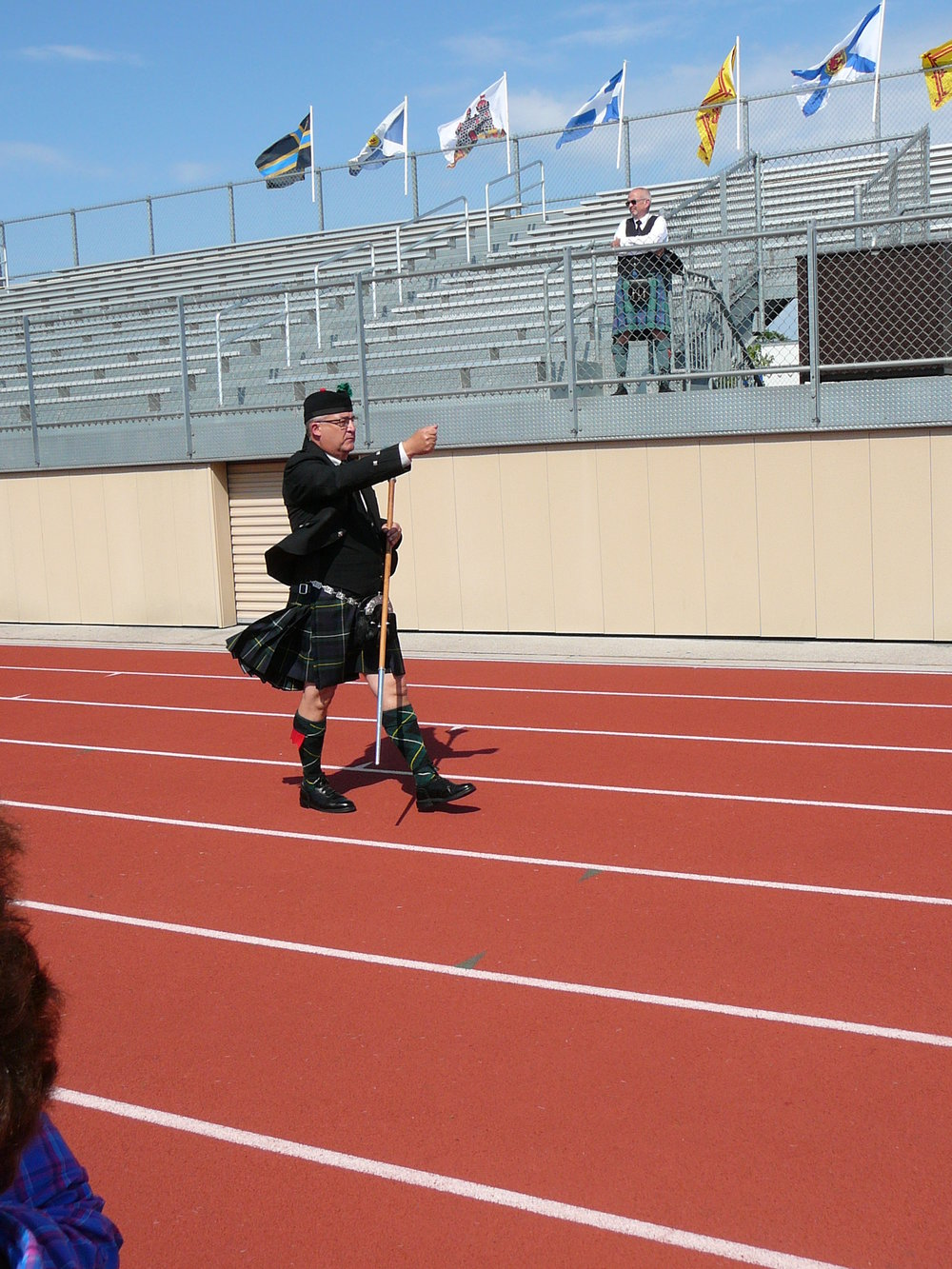 Drum Major Doug Weisheit leading the band out of the field.