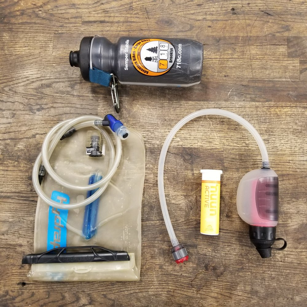 Water Gear:  From Top/Clockwise:  718 Water Bottle ,  MSW TrailShot Water Filter , Nuun Electrolytes Hydration Tablets, 2L water bladder.