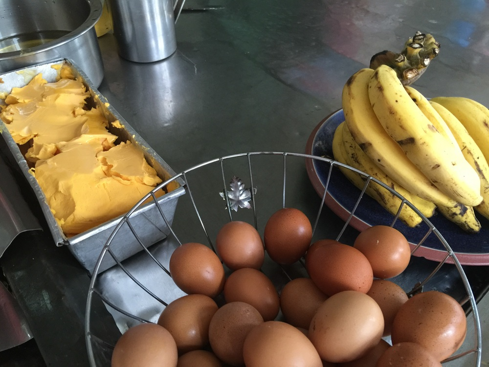 Eggs, banana, and a tub of orange lard. Only tasty goodness shall come of this!