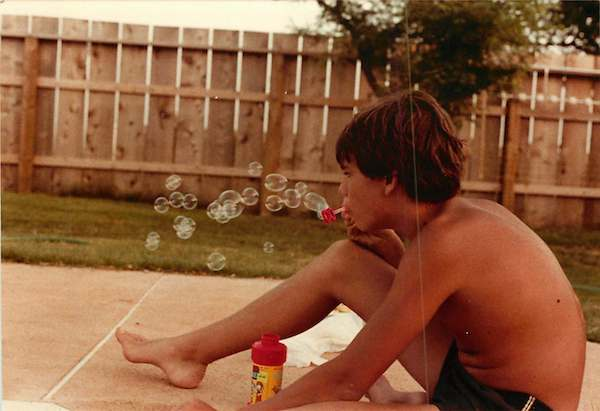 Why travel, when I can blow bubbles next to my pool? Image via Evo Terra's mom.