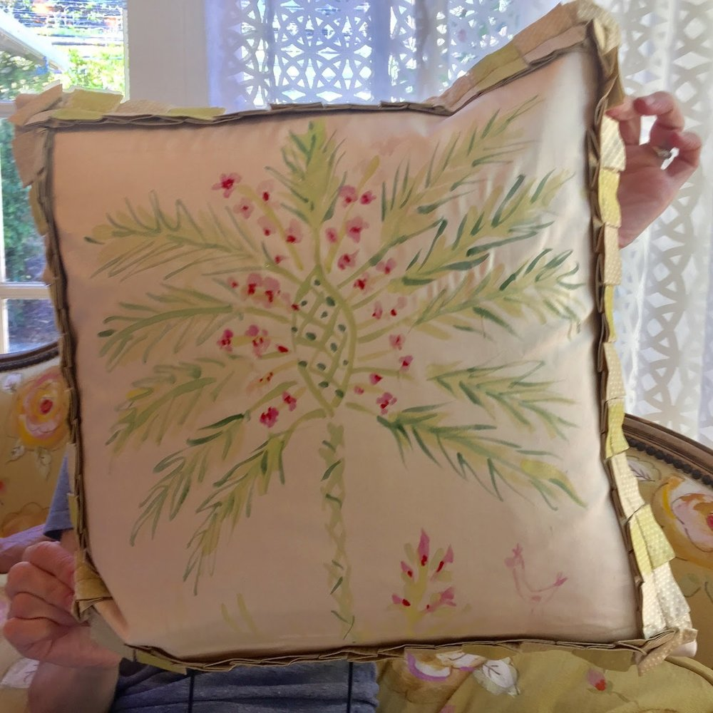 We hand painted pillows. I painted a tropical palm leaf!