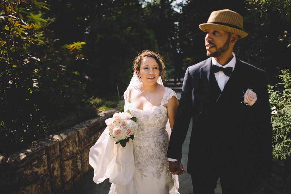Bride and groom walk together at Brookside Gardens in Silver Spring, MD.