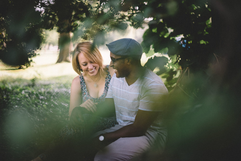 A Richmond, Virginia couple laugh during their engagement session.