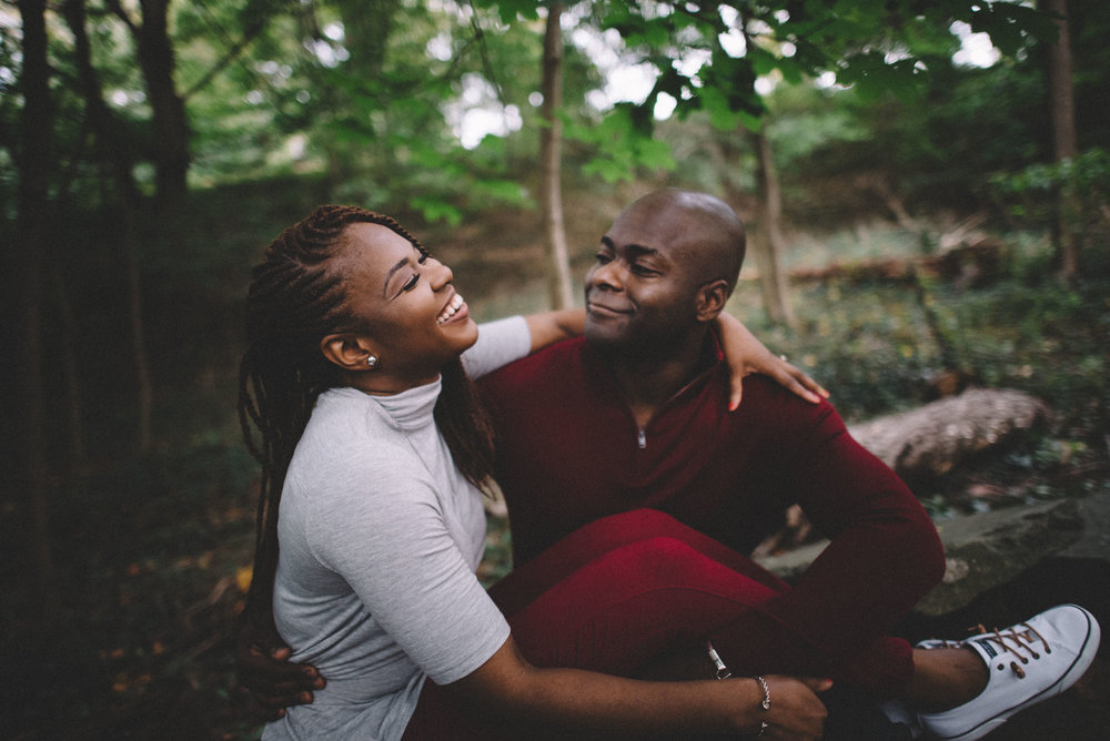 A couple shares laughs during their engagement session in the Georgetown neighborhood of Washington, DC.