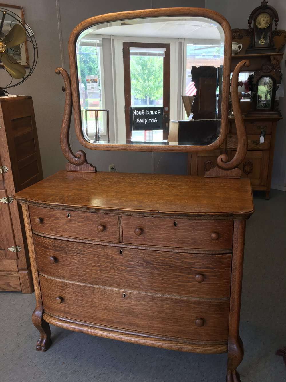 Beautiful bow front dresser with claw feet. Simple yet elegant! Measures 42 wide and 21.5 depth.