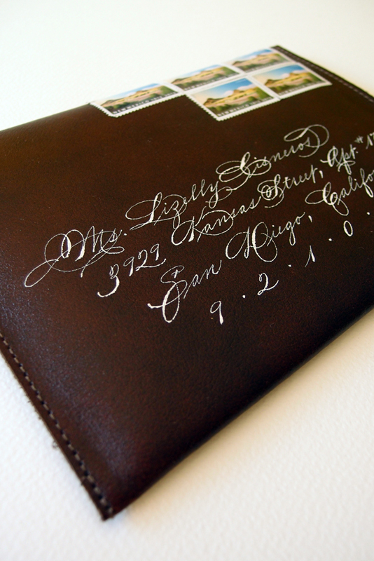 Beautiful Spencerian calligraphy by Bill Kemp on homemade leather envelopes