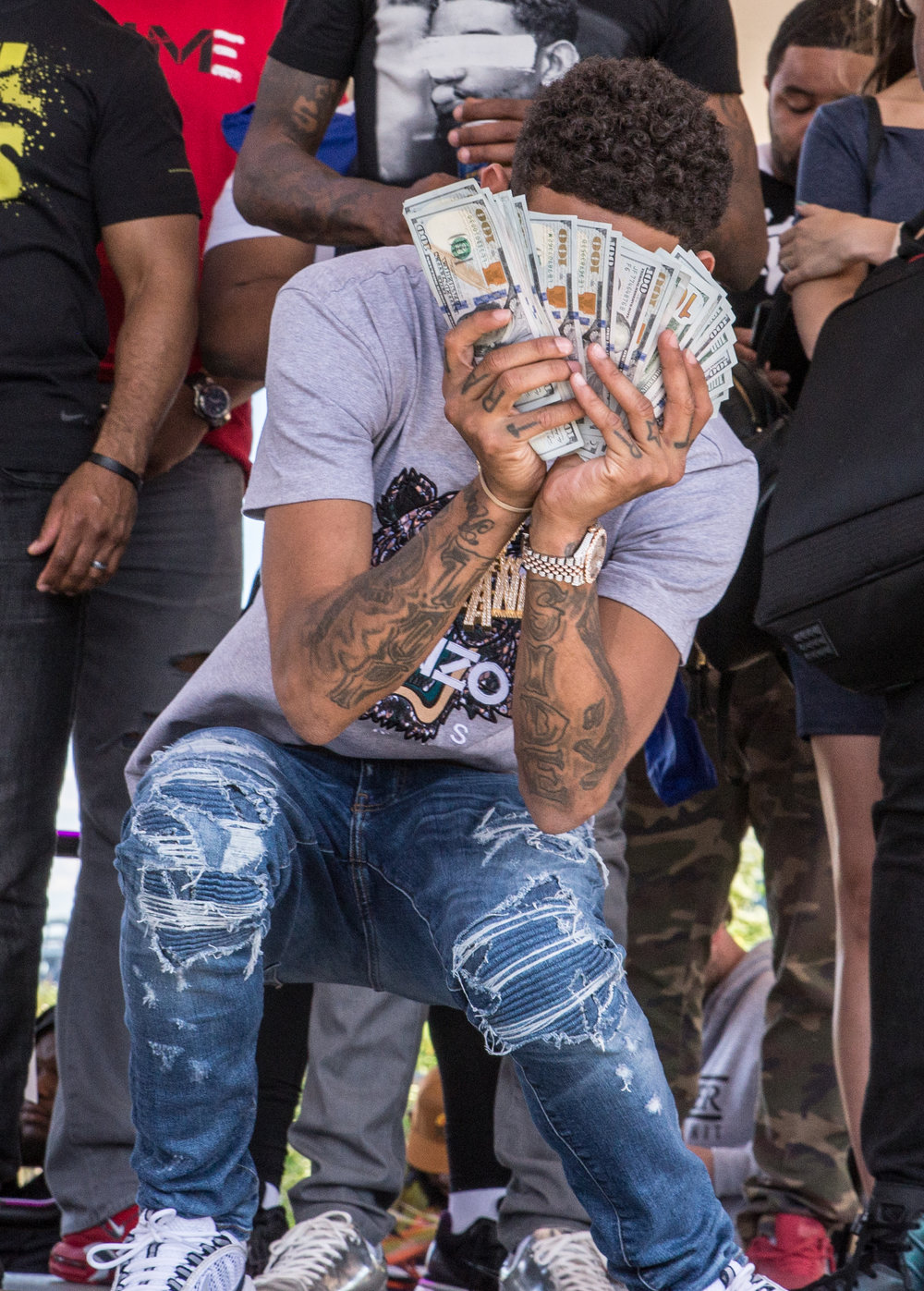 Pnb Rock flashes cash for the camera