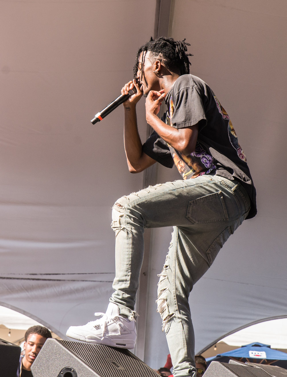 Playboi Carti - Unfortunately for him the only thing stopping all the girls was a metal barricade and two anxious looking security guards. The obstacles didn't stop the crowd from belting out song after song. He hyped up the crowd enough to start a mosh pit!
