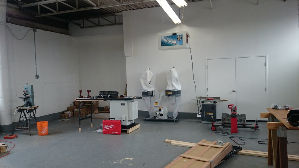The wood shop area, slowly taking shape. We really need to add some workbenches.