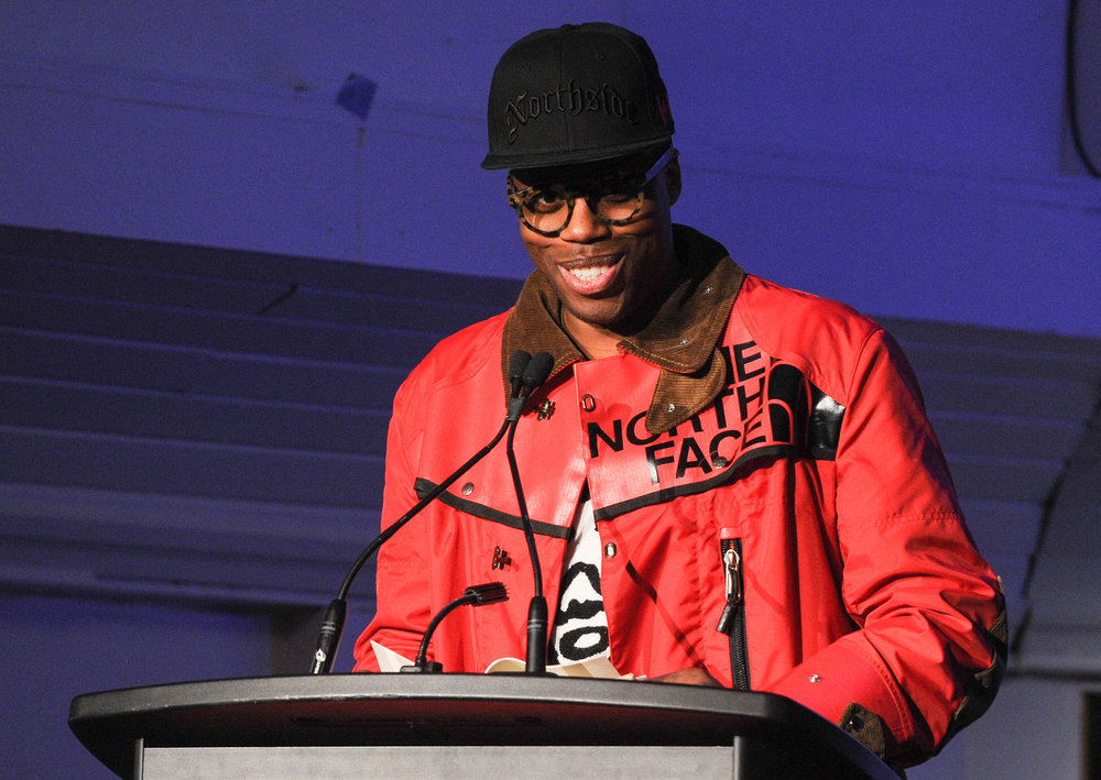"Kardinal Offishall  |  Canadian Rapper, Record Producer - The evening began with Kardinal Offishall who taught us the Patois phrase ""No cuss alligator long mout' till yu krass riva"" while reading from G. Llewellyn Watson's Jamaican Sayings."