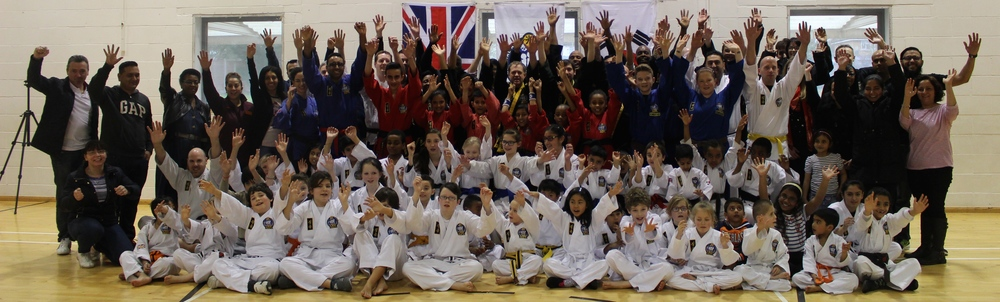 Instructors, children, students and parents all enjoying World Choi Kwang Do day....